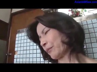 milf with hairy pussy fisting herself on the