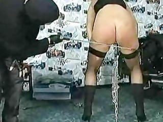 masked master spanks woman slave with giant