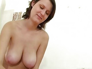 grownup chick with giant chest gives a handjob