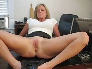 mature pale secretary spreads her foot and