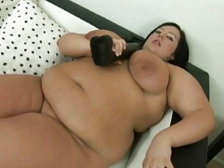 big ebony haired momma with giant boobs uses her