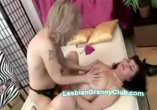 older blonde sweetheart with strapon copulates