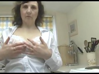 naughty mature girl slowly strips down to