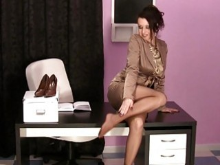 hot woman inside the bureau putting on satin