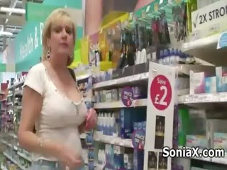 mature babe exposes sexy assets into public