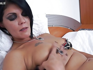 mature bitch lady pushing dildo on her bed