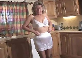 adorable granny in dark hose toying on the steps