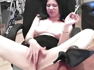 awesome cougar lady named mina rubs an hand
