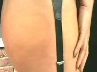 pale lady slave with bit breast bends over and