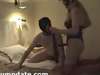 lady having on strapon and her hubby sucks it